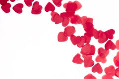 Scattered red hearts on a white background. Excellent background to the day of Saint Valentine.copy space stock image