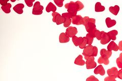 Scattered red hearts on a white background. Excellent background to the day of Saint Valentine.copy space stock photography