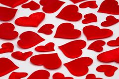 Scattered Red Hearts on White Background stock images
