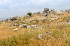 Scattered remnants of ruined stone buildings Royalty Free Stock Photo