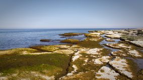 Öland costal view. Scattered rocks on the coast beach of Swedens island of Öland royalty free stock photo