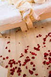 Scattered rose petals. Red rose petals scattered all over the floor Stock Photo