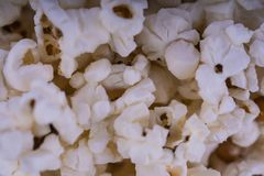 Scattered salted popcorn, food texture background. Fastfood popular during a movie in a cinema. Popcorn texture. Popcorns. stock photography