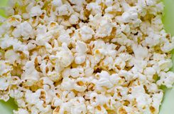 Scattered salted popcorn. Texture background Stock Image