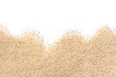 Scattered sand. On white background royalty free stock photography