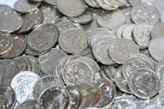 Scattered silver five cent coins. Royalty Free Stock Image