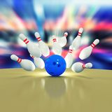 Scattered skittles and bowling ball Royalty Free Stock Image