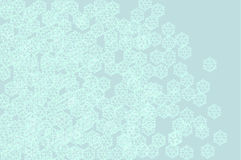 Scattered snow crystals art background. This arty illustration of snow crystals on pale blue suit a sitution where a soft impressionistic winter theme is Royalty Free Stock Image