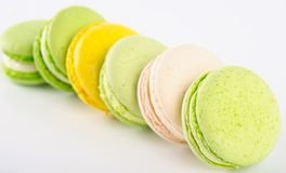 scattered stack of yellow-green dessert macaron , on a light background royalty free stock images