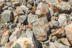 Scattered stones texture, pile of rocks boulders. For constructions royalty free stock photos