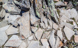 Scattered stones texture, pile of rocks boulders. For constructions stock photos