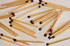 Scattered on the table matches. Stock Photos