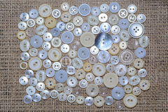 Scattered on textile buttons Royalty Free Stock Photo