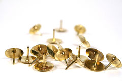 Scattered Thumb Tacks. Isolated on a white background royalty free stock photography