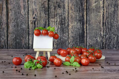 Scattered tomatoes and canvas on the easel. stock image