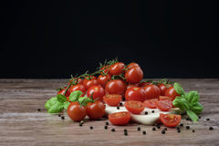 Scattered tomatoes on the wooden table. Royalty Free Stock Photo