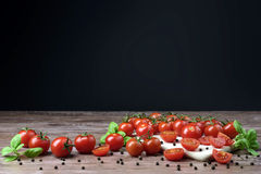 Scattered tomatoes on the wooden table. Stock Photos