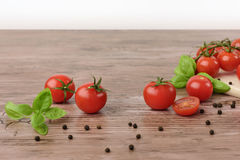Scattered tomatoes on the wooden table. stock image