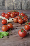 Scattered tomatoes on the wooden table. Royalty Free Stock Image
