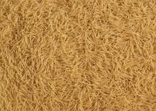 Scattered vermicelli texture background. Scattered uncooked vermicelli texture background Stock Photos