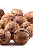 Scattered walnuts. On white background Stock Images