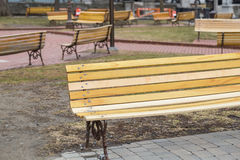 Scattered Yellow Benches Royalty Free Stock Images