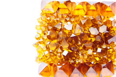 Scattered yellow Monocrystal synthetic diamonds Royalty Free Stock Photography