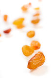 Scattered yellow raisins over white Stock Photos