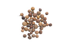 A scattering of allspice on a white background Royalty Free Stock Images