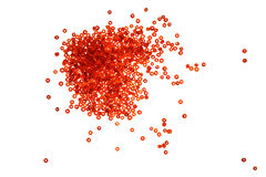 A scattering of beads. A scattering of bright red beads on a white background Royalty Free Stock Images