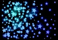 A scattering of blue stars on a black background. Royalty Free Stock Image