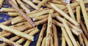 Sweet straw in bulk. On a scattering of bread crumbs in bulk sweet straw stock video footage