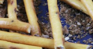 Sweet straw in bulk. On a scattering of bread crumbs in bulk sweet straw stock footage