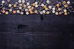 Scattering of buttons and shiny metal accessories for sewing Royalty Free Stock Photo