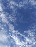 Scattering clouds background. Background of scattering white clouds in blue sky Stock Photo