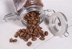 The scattering of coffee beans maragogype of transparent banks Stock Photo
