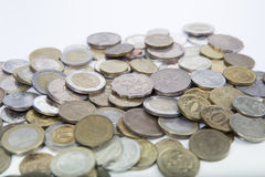 A scattering coins from different countries on a white backgroun. A scattering coins from different countries and of different denomination on a white background Stock Photo