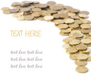 A scattering of coins isolated Royalty Free Stock Photo