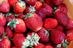 Scattering of dark red strawberry Royalty Free Stock Photos