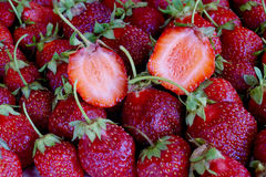 Scattering of dark red strawberry Royalty Free Stock Images