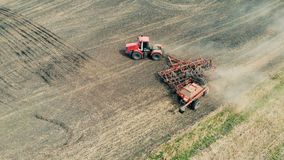 Agricultural machine is turning around on a agricultural field. Scattering machine is turning around on a spacious field. 4K stock footage