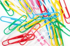 Scattering of multi-colored paper clips Royalty Free Stock Image