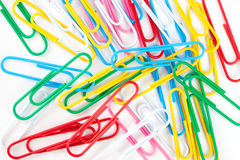 Scattering of multi-colored paper clips Stock Photography