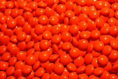 A scattering of red pills. The possibility of addiction to the medication and excess dosage Stock Images