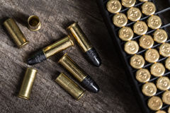 Scattering of small caliber cartridges on a wooden Stock Image