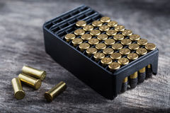 Scattering of small caliber cartridges on a wooden Stock Photos