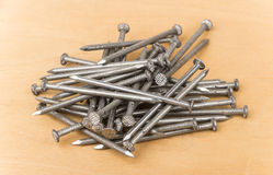 Scattering of steel nails on table Royalty Free Stock Photography