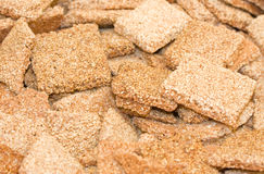 A scattering of sweet tasty sesame cookies Royalty Free Stock Photography