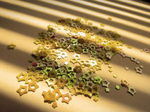 Scattering of yellow stars and sequins Stock Images