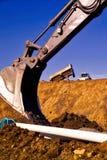 Scavando su un cantiere Fotografia Stock Libera da Diritti